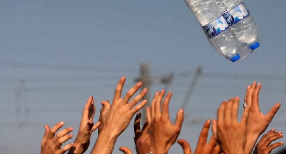 市水利和湖泊局现场协调解饮水难题