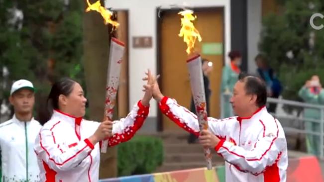 军运会火炬传递活动在武汉举行