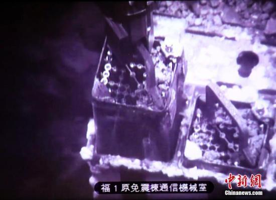 福岛核事故损毁厂房:面目全非 需穿多层防护服进入