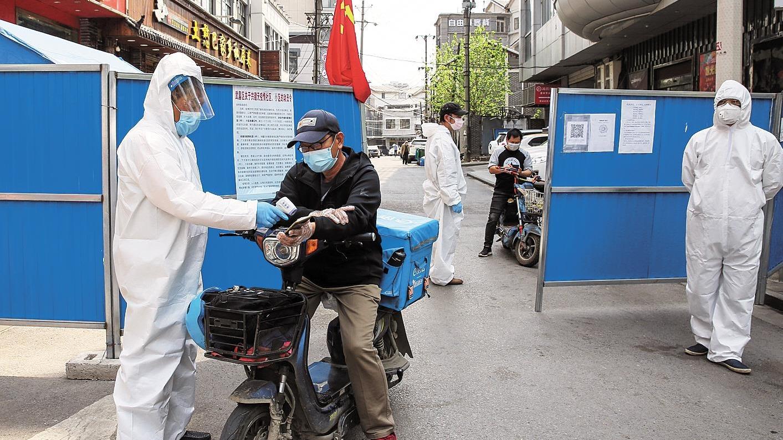 人员不断档 防控不松懈——记者探访武汉社区