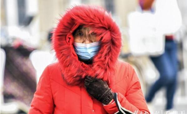 北风不停吹,阳光没温度!江城市民体会彻骨寒冷